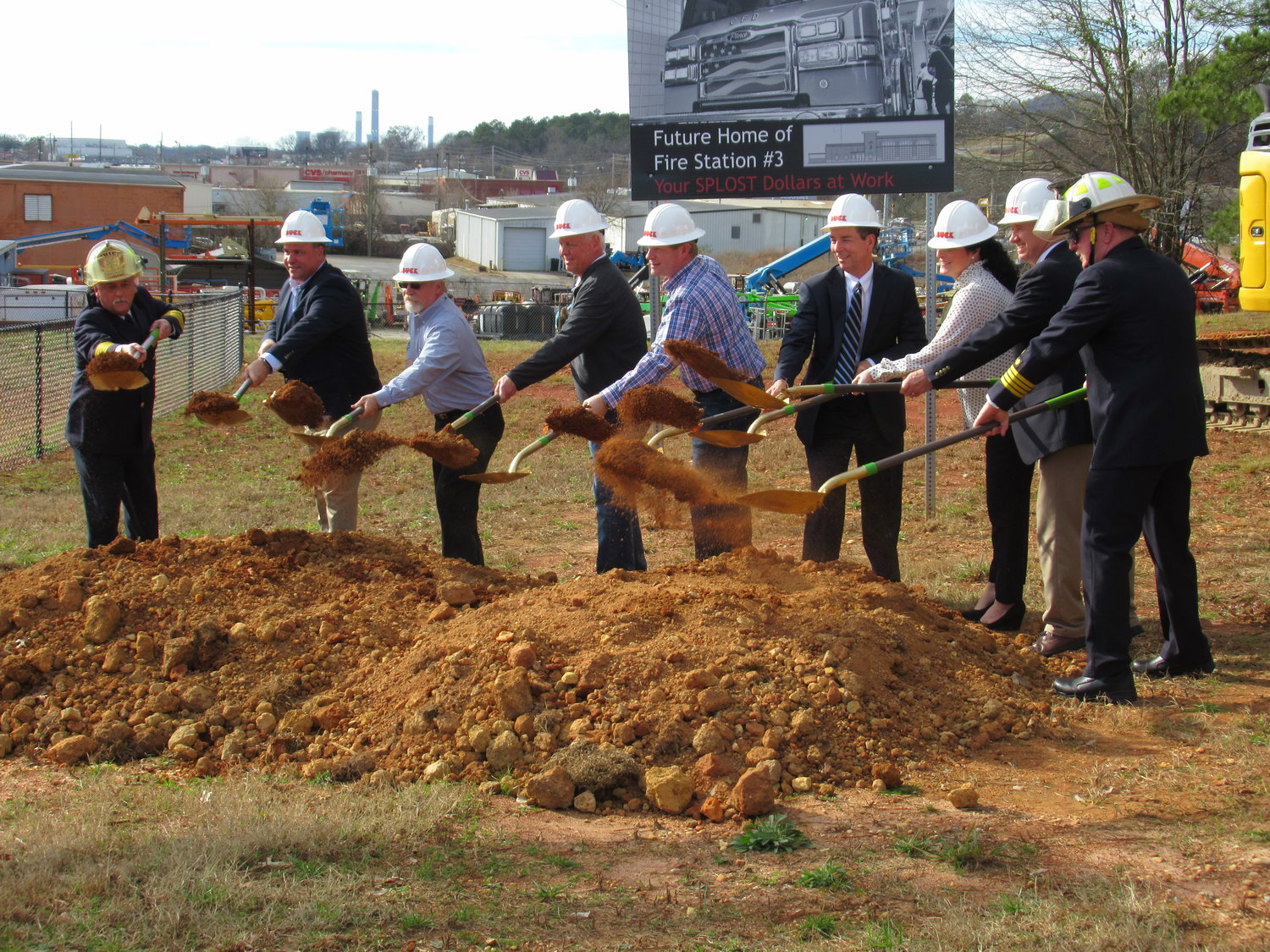 Several City of Cartersville representatives join Fire Chief Scott Carter for Monday's groundbreaking ceremony.