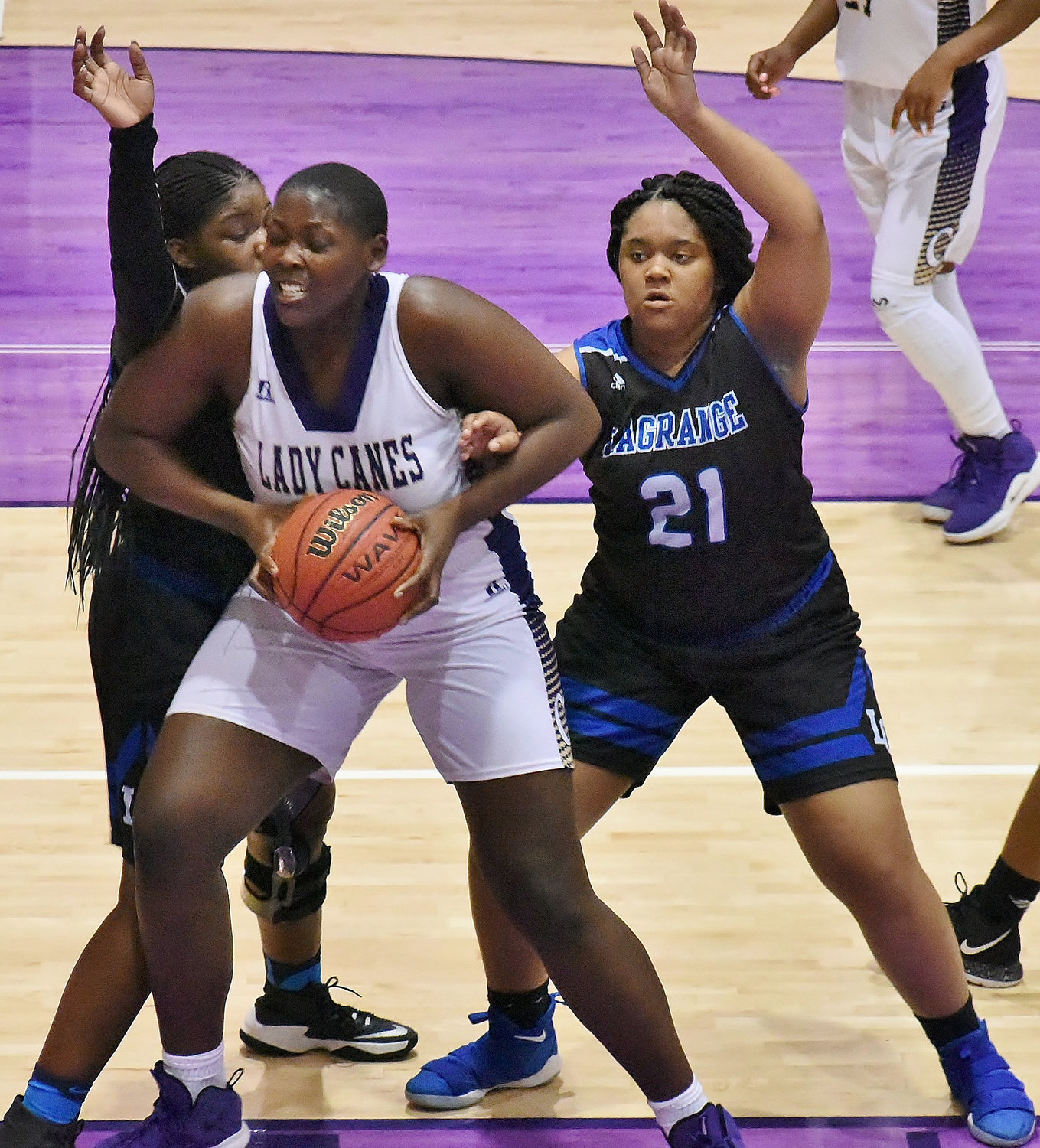 Cartersville senior London Shaw fights inside against LaGrange during Tuesday's home game at The Storm Center. Shaw posted a double-double with 16 points and 10 rebounds to help boost the Canes to a 50-44 victory.
