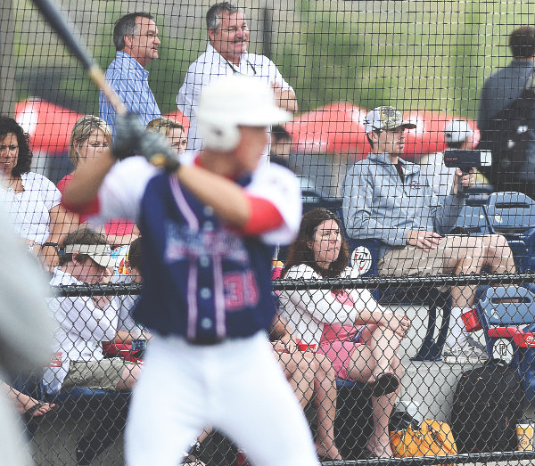 A scout clocks the velocity of an incoming pitch during a baseball game in 2014 at LakePoint.