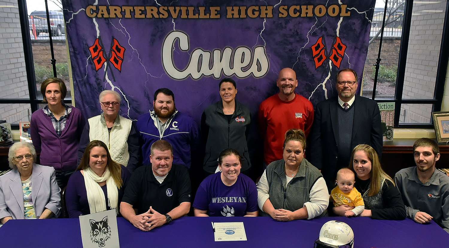 Cartersville High senior Presly Edwards signed to play softball at Wesleyan College in Macon on Dec. 13 in the school's media center. On hand for the signing were, from left, front row: Jean Reeves, grandmother; Tiffany Edwards, stepmother; Shane Edwards, father; Amy Edwards, mother; Campbell Edwards, niece; Peyton Zieminick, sister; Nick Zieminick, brother-in-law; back row, Shelley Tierce, CHS principal; Becky Lowry, aunt; Alex Chastain, assistant softball coach; Shannon Suarez, head softball coach; Evan Johnson, Georgia Fire coach; and Darrell Demastus, CHS assistant principal and athletic director.