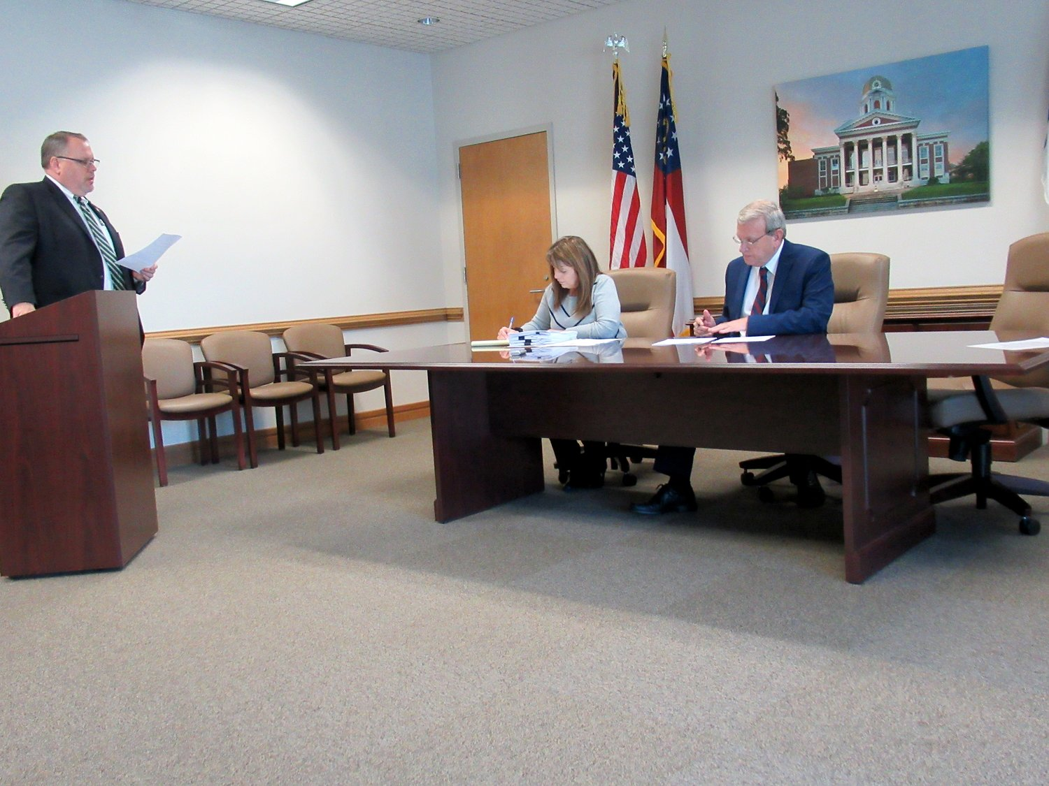 From left, Bartow County Administrator Peter Olson, County Clerk Kathy Gill and County Commissioner Steve Taylor at Wednesday's public meeting.