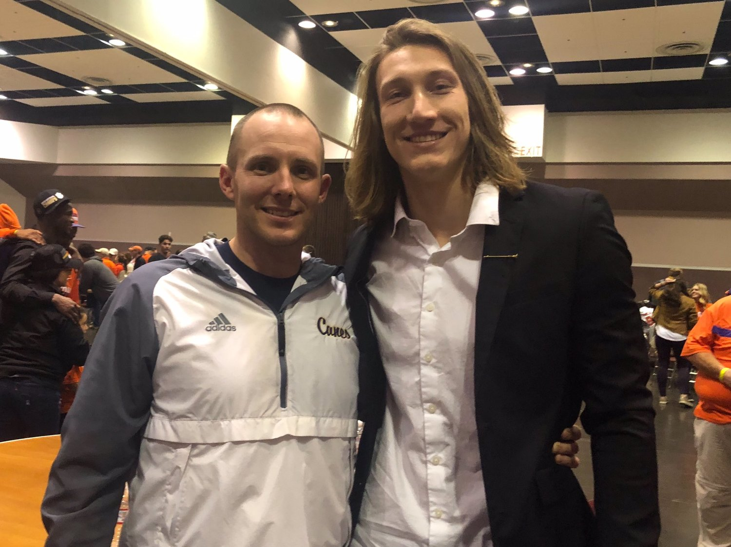 Cartersville High head football coach Joey King poses for a picture with former Canes quarterback Trevor Lawrence after Lawrence led Clemson to the national championship Monday night.