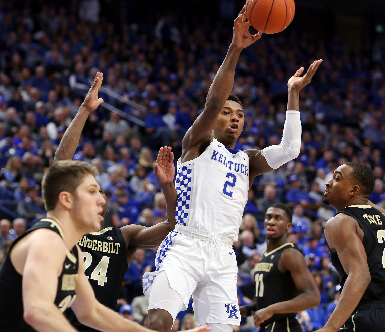 Kentucky's Ashton Hagans (2) passes between, from left, Vanderbilt's Matt Ryan, Aaron Nesmith, Simisola Shittu and Joe Toye during the second half of an NCAA college basketball game Saturday in Lexington, Kentucky. Hagans landed SEC Freshman of the Week honors due to his performances against Vanderbilt and Texas A&M over the past week.