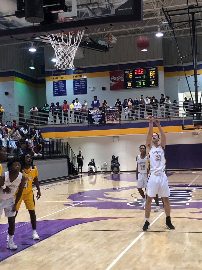 Cartersville senior Isaac Gridley knocks down a free throw in the final seconds of an 88-76 home win over Troup County on Friday at The Storm Center.