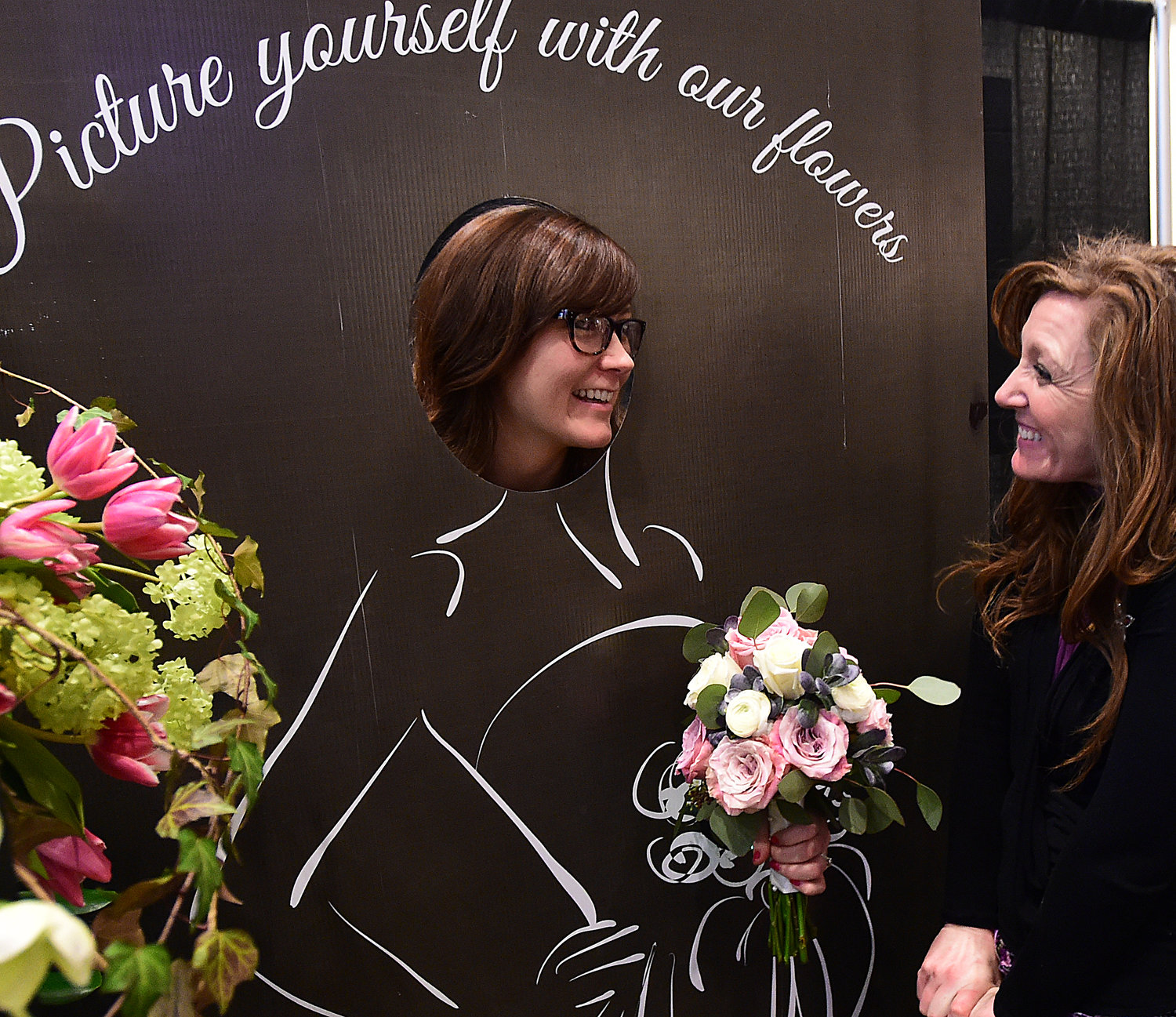Adairsville's Ashley Phillips, left, has some fun with Andrea Calhoun with Bussey's Flowers, Gifts & Decor at a previous Northwest Georgia Bridal Expo.