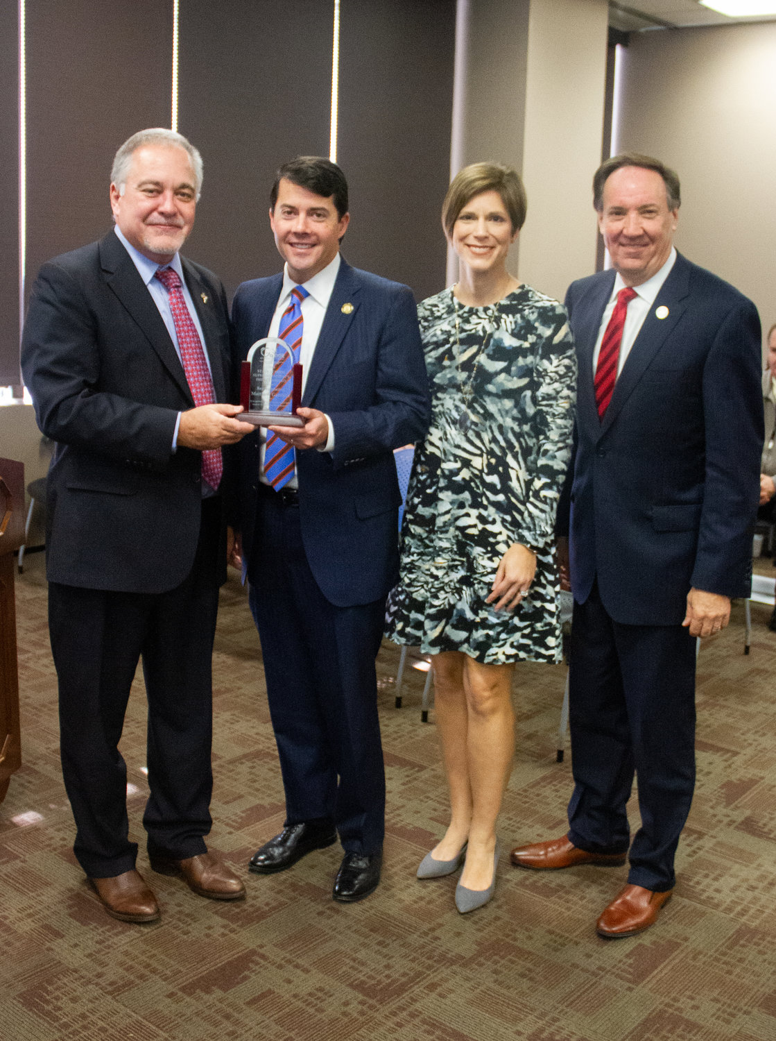 Celebrating with Superintendent's Impact Award winner state Rep. Matthew Gambill, second from left, are, from left, State School Superintendent Richard Woods, Danae Gambill and State Board of Education Chairman Scott Johnson.