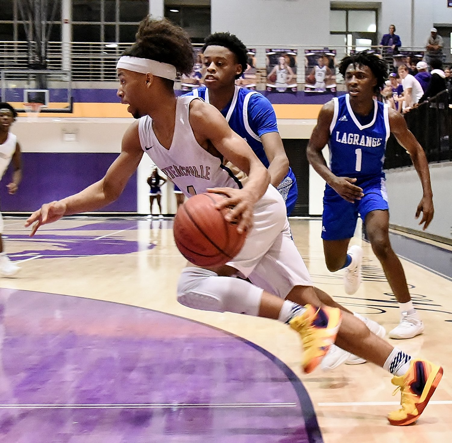 Cartersville senior Perignon Dyer drives towards the basket during Wednesday's quarterfinal matchup with LaGrange in the Region 5-AAAA tournament at The Storm Center. Dyer finished with 18 points to lead the Canes to a 61-55 victory and a spot in the Class 4A state playoffs.