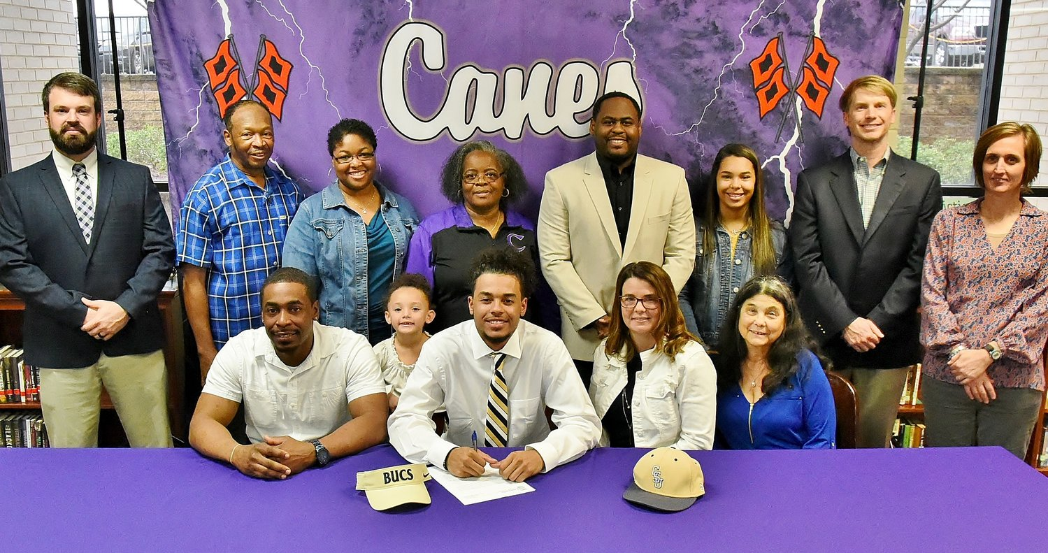 Wednesday was National Signing Day, on which Cartersville High School senior Kaleb Chatmon signed to play football at Charleston Southern University in North Charleston, South Carolina. On hand for the signing were: from left, front row, Cortney Chatmon, father; Peyton Turner, sister; Tammy Chatmon, mother; Mary Robinson, grandmother; back row: Dusty Phillips, CHS assistant football coach; Vance Henderson, grandfather; Dr. Damian Elder, aunt; Helen Chatmon, grandmother; Jim Jones, CHS assistant coach; Madison Chatmon, sister; Conor Foster, CHS assistant coach; and Shelley Tierce, CHS principal.
