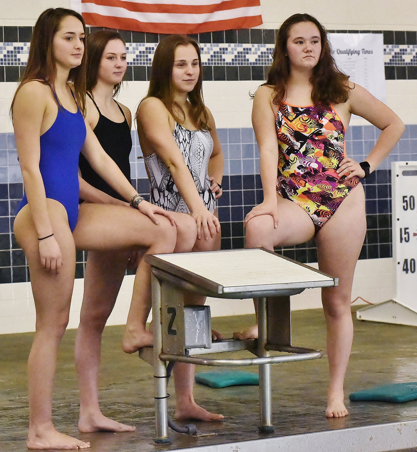 Adairsville swimmers, from left, Mallory Cook, Harper Powell, Rylee Moss and Kayleigh Rice stand on the pool deck during a recent swim practice at the high school's pool. The group was the first Adairsville girls team in school history to reach the GHSA state swim championships in a relay event and ended up qualifying in all three. On Friday, they cut times in the state prelims to reach Saturday's finals in the two relay events in which they competed.