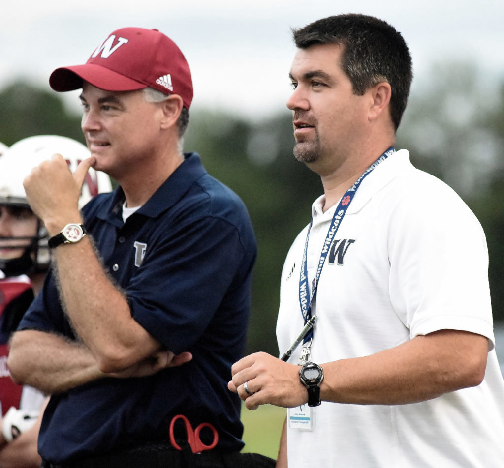 Woodland High's principal Wes Dickey, left, and athletic director John Howard converse before the Wildcats faced Adairsville in a football scrimmage last August.