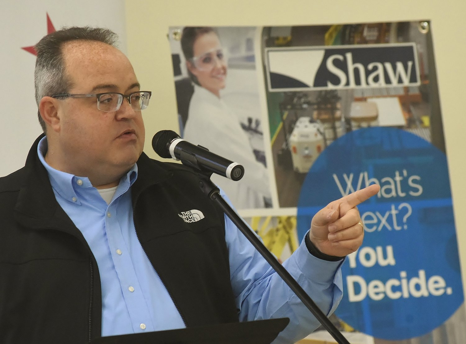 Shaw Industries' Director of International Soft Services Nolan Howell spoke about expansion plans for Adairsville's Plant T1 at Thursday morning's Cartersville-Bartow County Chamber of Commerce presentation at Northpointe Church.