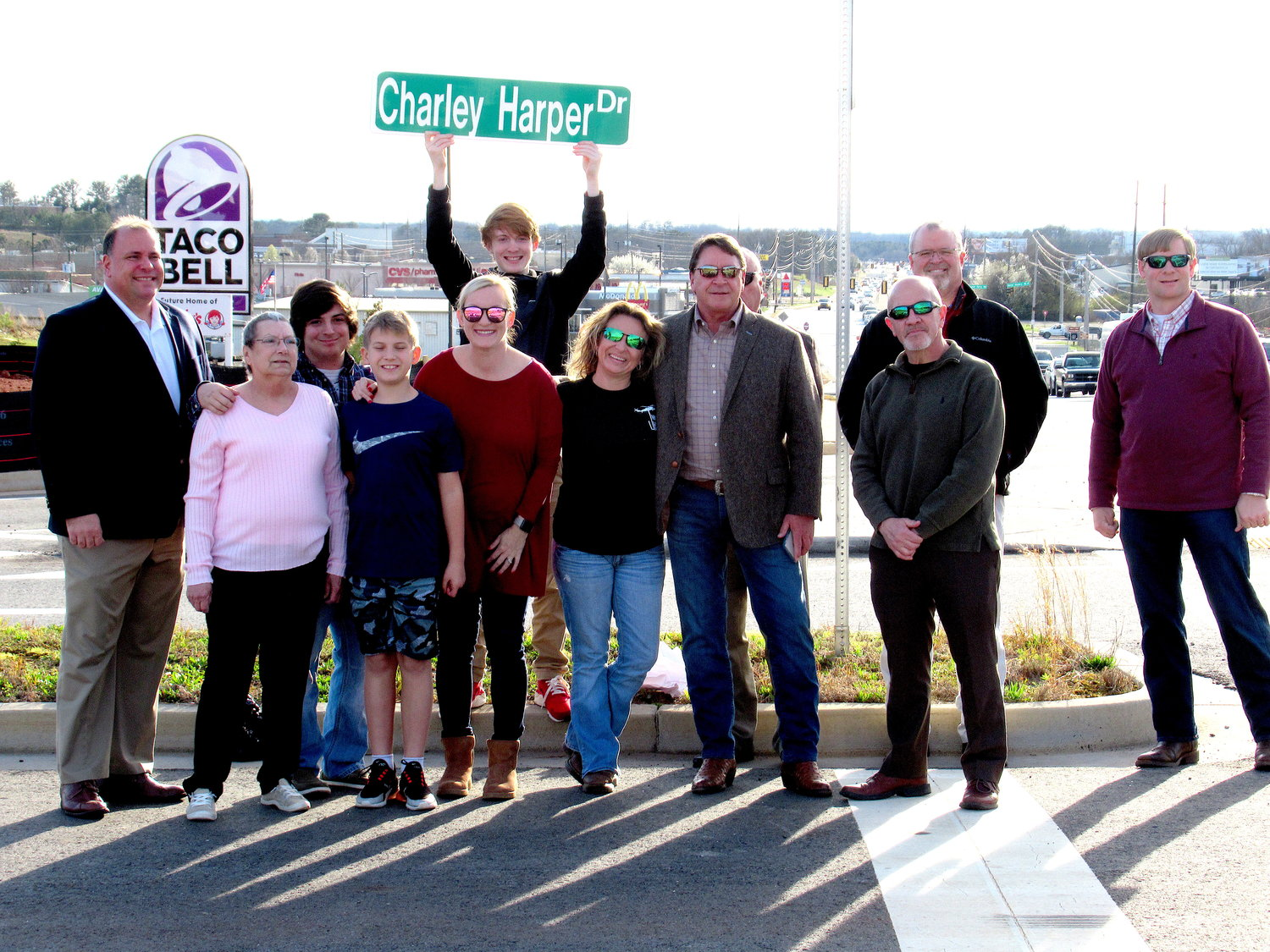 About a dozen people turned out Monday afternoon for a dedication ceremony officially renaming Village Hill Drive in West Cartersville after the late Charley Harper.