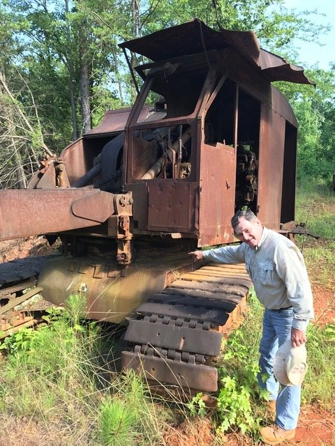"Stan Bearden, shown here pointing to an abandoned drag line, will deliver the ""Bartow's Tunnel Mining Age"" presentation with Etowah Valley Historical Society Vice President Joe Head Tuesday."