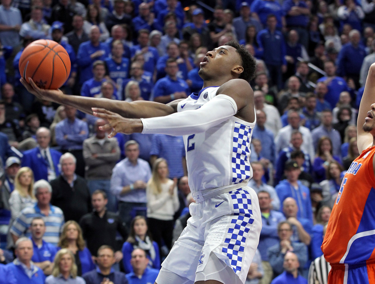 Kentucky's Ashton Hagans, a Cartersville native, shoots near Florida's Isaiah Stokes, right, during Saturday's game in Lexington, Kentucky.