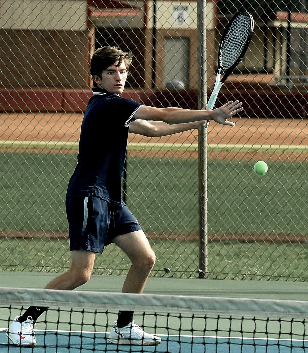 Woodland Line 2 singles player Connor Gunnell prepares to hit a forehand during Tuesday's match against Cass at Hamilton Crossing. Gunnell earned a 6-0, 6-0 win to help the Wildcats pick up a 3-2 victory over the Colonels.