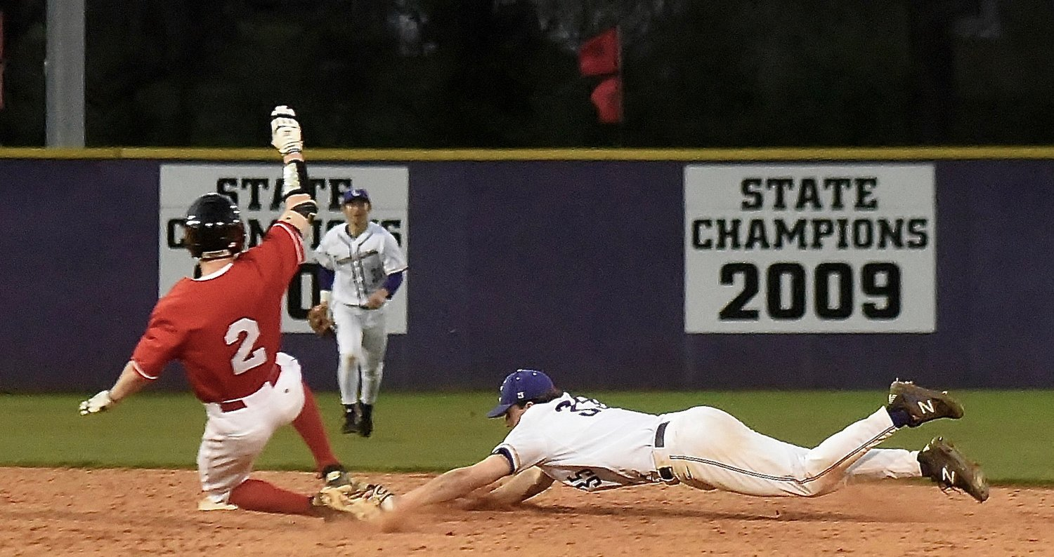 Cartersville second baseman Josh Davis dives to tag a runner for the final out of the Canes' 3-0 victory at home Thursday against Alexander.