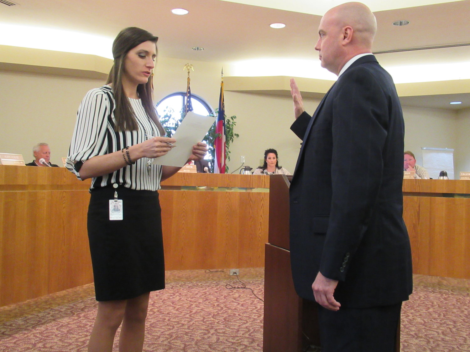 Cartersville City Clerk Meredith Ulmer swears in the City's new parks and recreation director Tom Gilliam, shortly after the council voted 4-1 to approve his appointment.