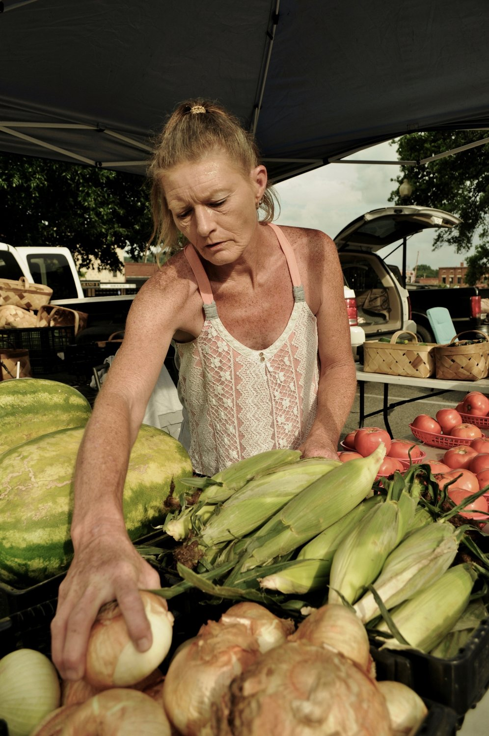 Teresa Lane of Emerson arranges onions in her display of vegetables at last year's Cartersville Farmer's Market.