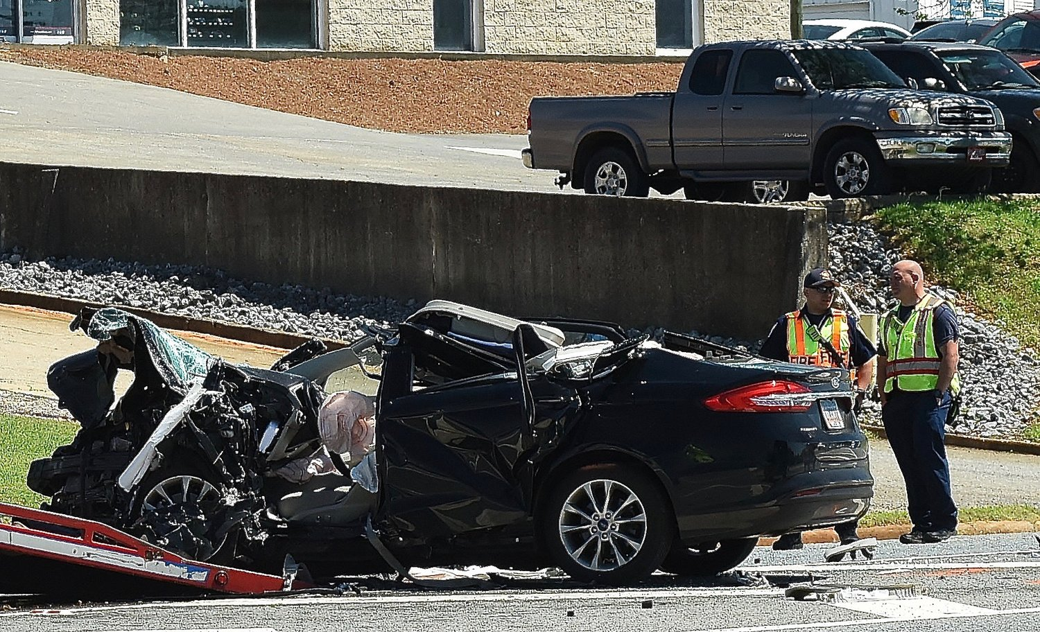 A two-car, head-on collision at the intersection of Joe Frank Harris Parkway and Collins Drive in Cartersville early Monday afternoon resulted in the death of a 52-year-old Cartersville woman and the airlifting of the other driver to Grady Memorial Hospital.