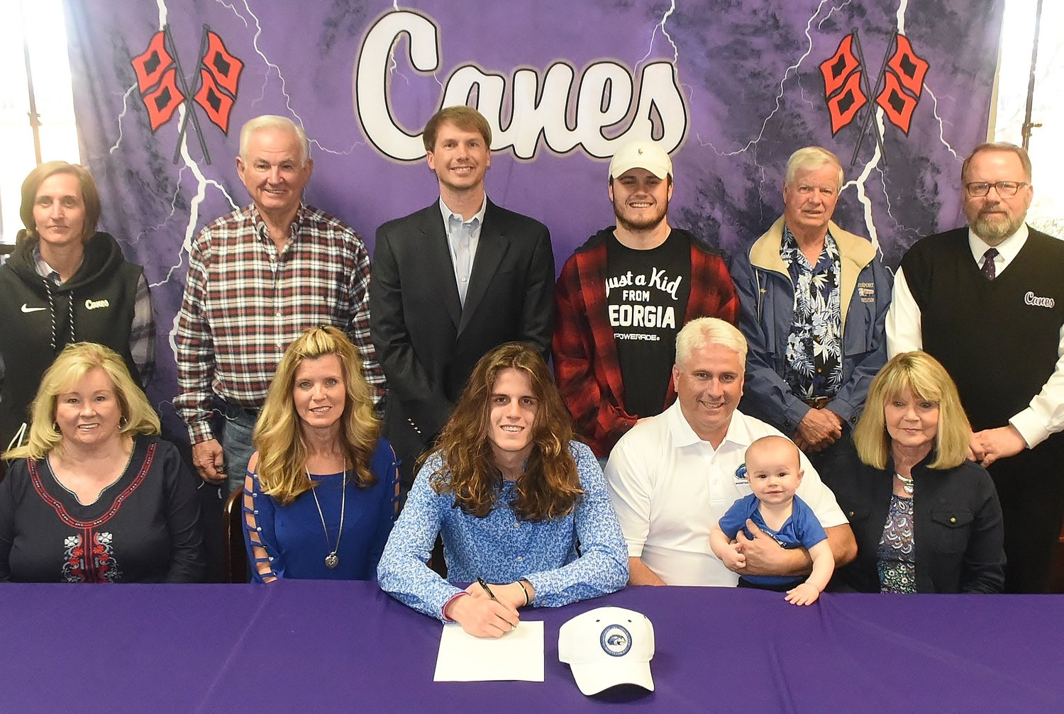 Cartersville High School senior Tristan Carlton signed to play football at Shorter University in Rome. On hand for the signing were, from left, front row, Martha Carlton, grandmother; Renae Carlton, mother; Robbie Carlton, father; Colt Carlton, nephew; Brenda Guy, grandmother; back row, Shelley Tierce, CHS principal; Tom Carlton, grandfather; Conor Foster, CHS head football coach; Trevor Carlton, brother; Billy Guy, grandfather; and Darrell Demastus, CHS athletic director.
