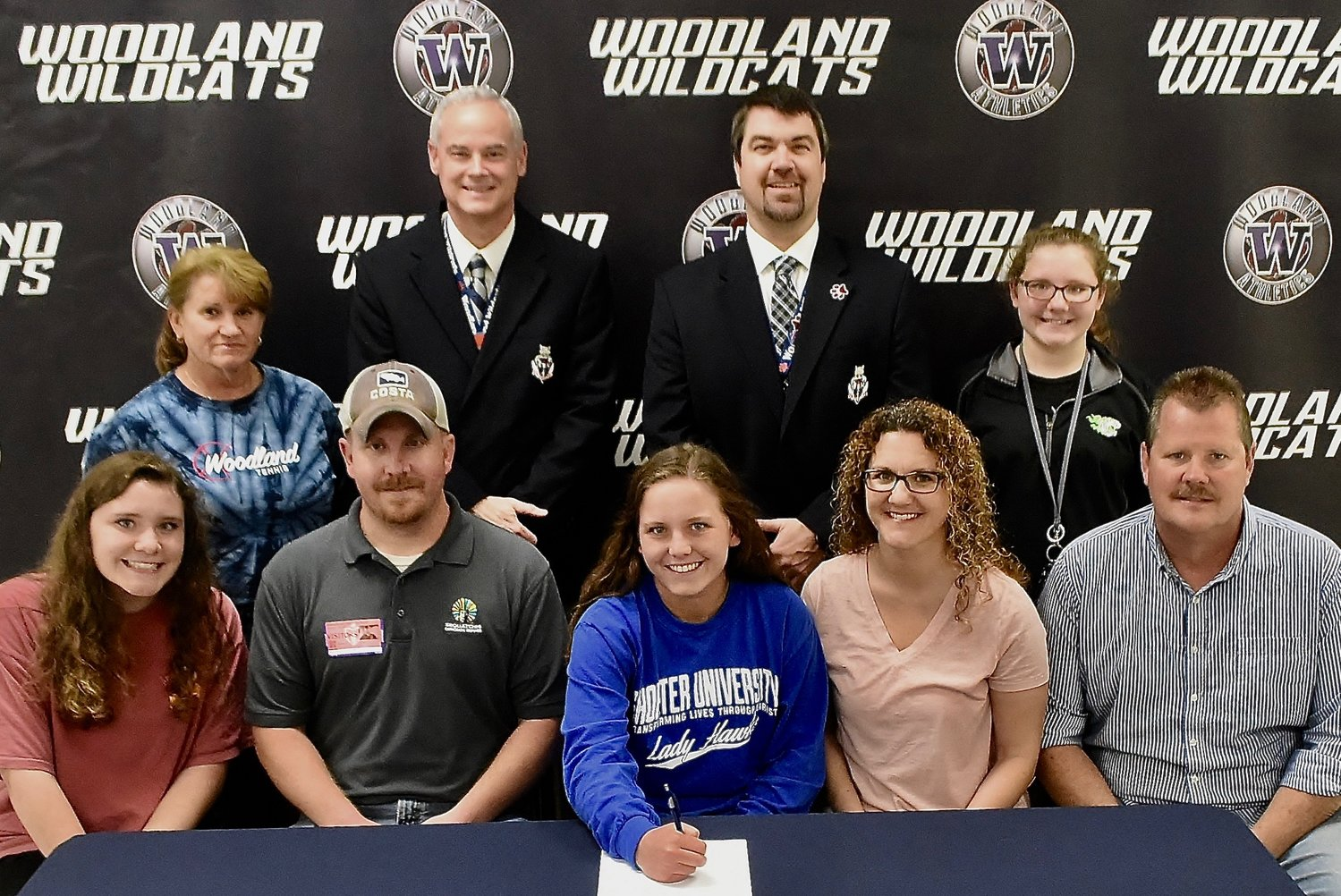 Woodland High senior Breanna Shook recently signed to play tennis at Shorter University in Rome. On hand for the signing were, from left, front row, MaKayla Dowdy, sister; Jeremy Shook, father; Lori Dowdy, mother; Kenneth Dowdy, stepfather; back row, Beth Heath, WHS head tennis coach; Wes Dickey, WHS principal; John Howard, WHS athletic director; and Ashlyn Dowdy, sister.