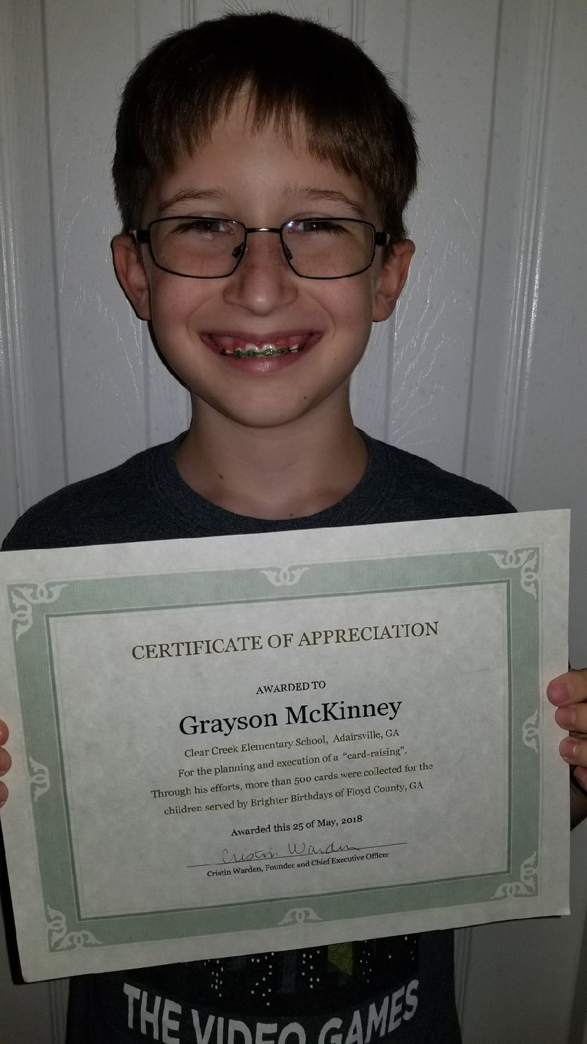 Brighter Birthdays presented Grayson McKinney with a certificate for the 500-plus cards he donated to help ensure no kids were forgotten on their birthdays.