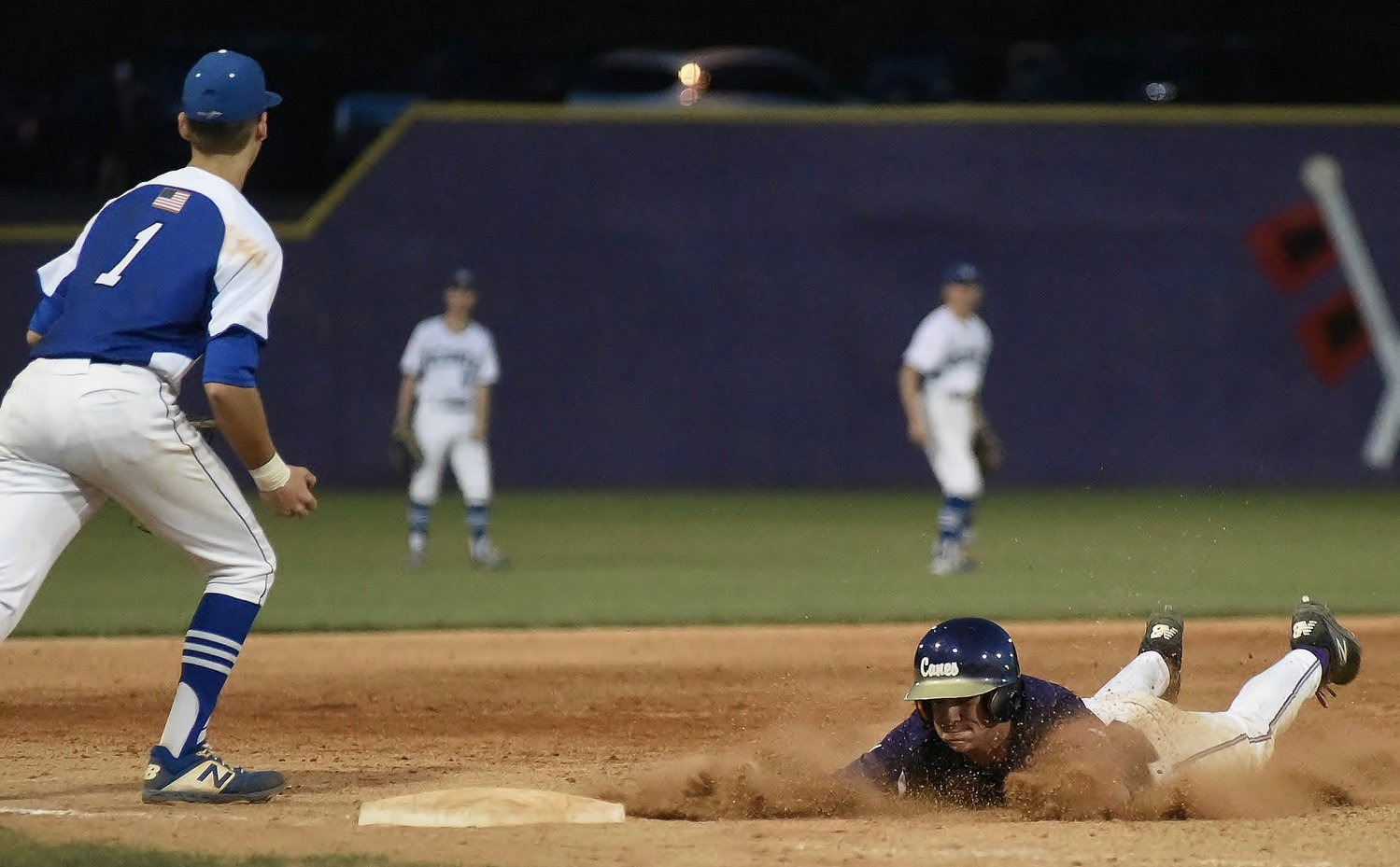 Cartersville's Davis Williams slides into third base after a throwing error by Oconee County during Game 2 of Wednesday's Class 4A state tournament first-round doubleheader. The Canes won both games in shutout fashion, 10-0 and 5-0, to advance to the Sweet 16.