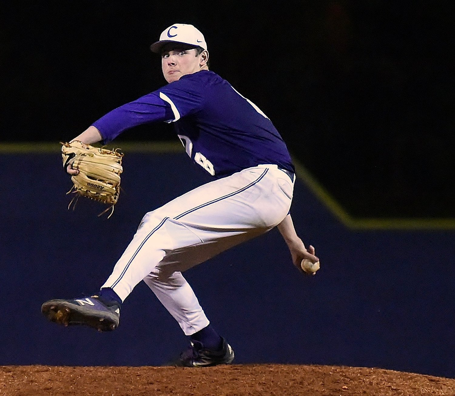Cartersville senior Logan Martin winds up to deliver a pitch during Game 2 of Wednesday's Class 4A state tournament first-round doubleheader against Oconee County. Martin struck out 11 in a complete-game shutout to help send the Canes to the second round.