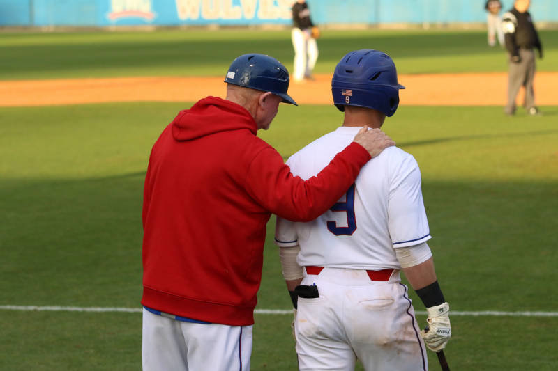 Adairsville grad Lane Griffith speaks with West Georgia head coach Skip Fite during a game earlier this season. Griffith had hits in all four of West Georgia's Gulf South Conference tournament games, as the Wolves went 2-2 in the event.