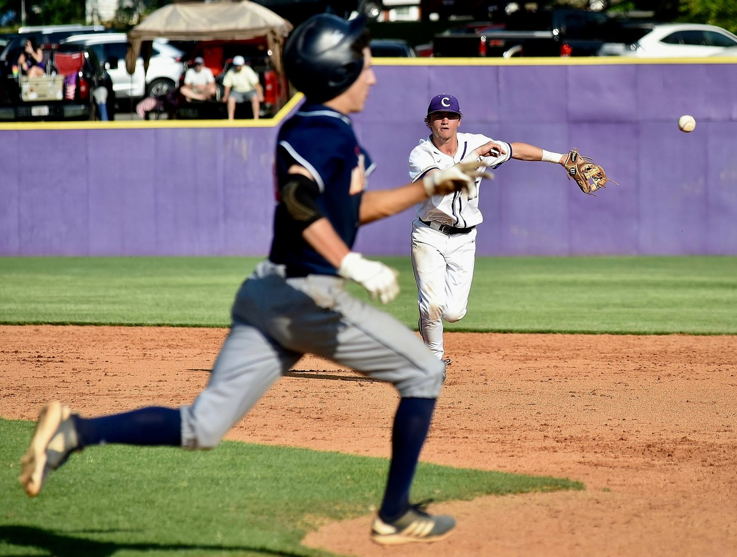 Cartersville junior Josh Davis throws a Northside-Columbus runner out at first base during Game 1 of a Class 4A state quarterfinal series Wednesday at Richard Bell Field.