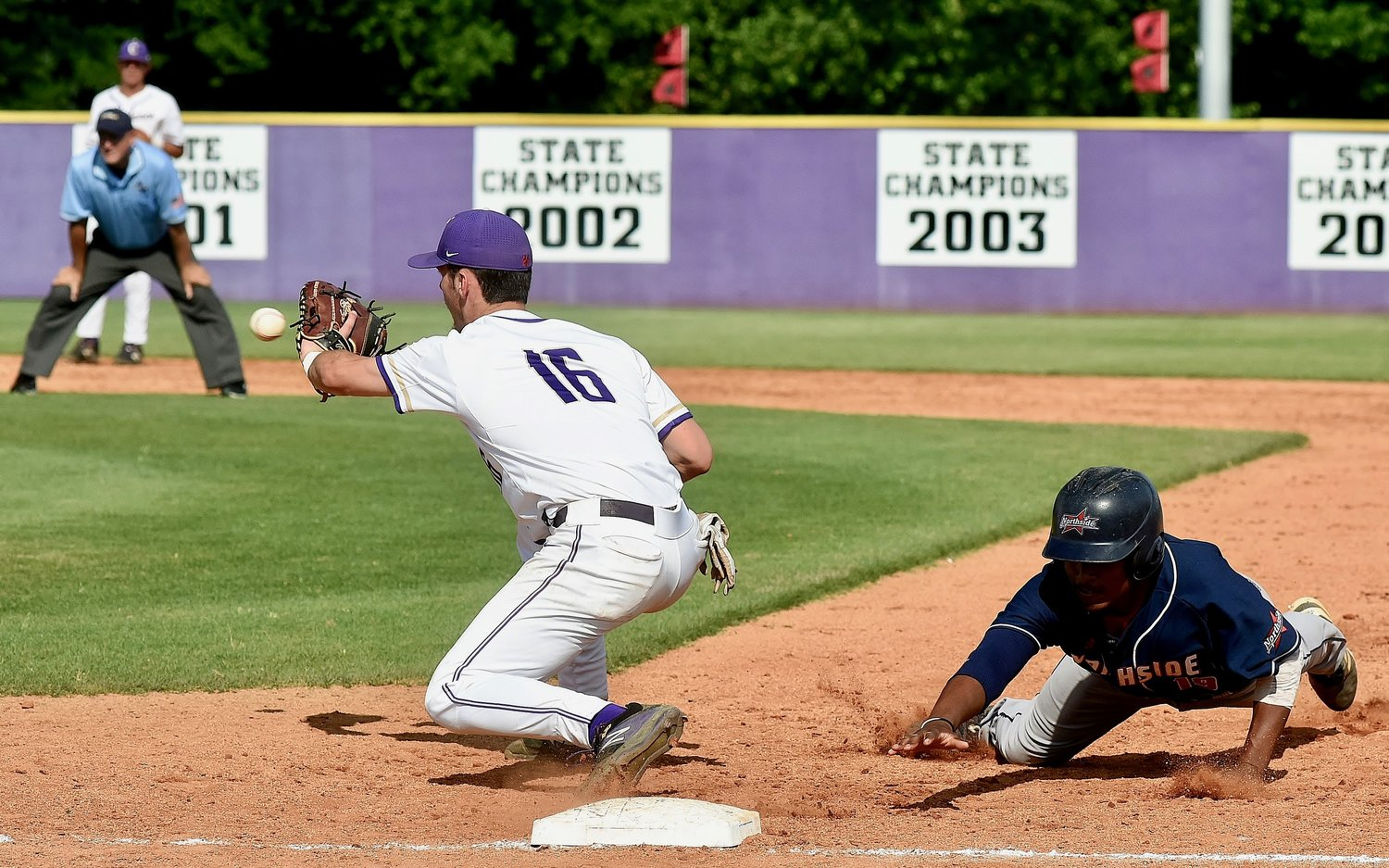 Cartersville senior J.P. Martin receives a pickoff throw at first base during Game 1 of a Class 4A state quarterfinal series Wednesday at Richard Bell Field.