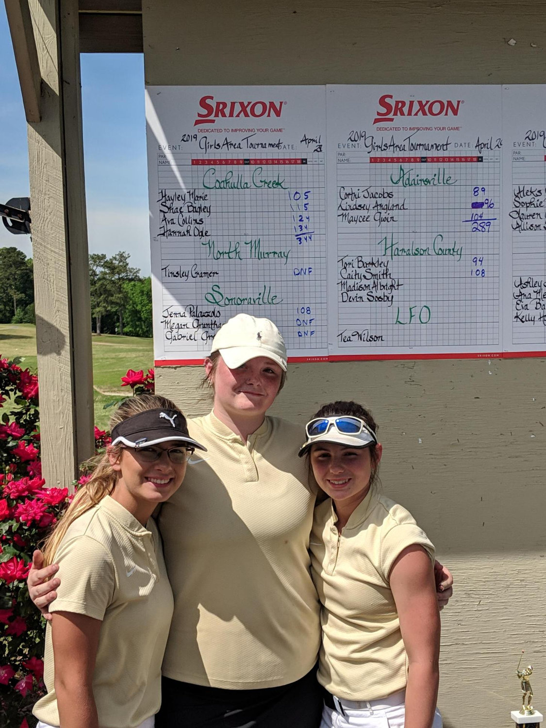 Members of the Adairsville girls golf team, from left, Maycee Gwin, Lindsey Angland and Cortni Jacobs, pose in front of their scores after completing their Class 3A Area 4 tournament on April 29 at Calhoun Elks Lodge and Golf Club. Next up for the Tigers is the Class 3A state tournament.