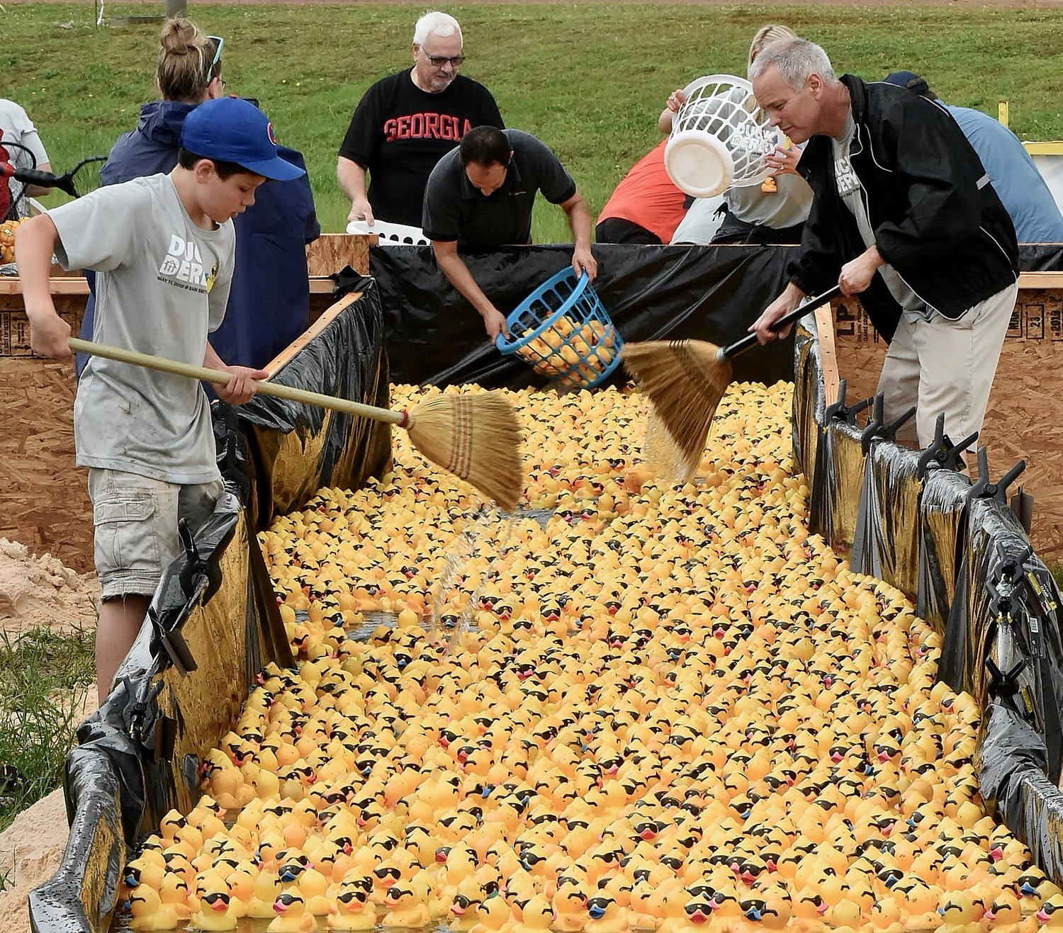 Ducks were swept into the gathering pool at the bottom of the race course during Saturday's Duck Derby at Sam Smith Park.