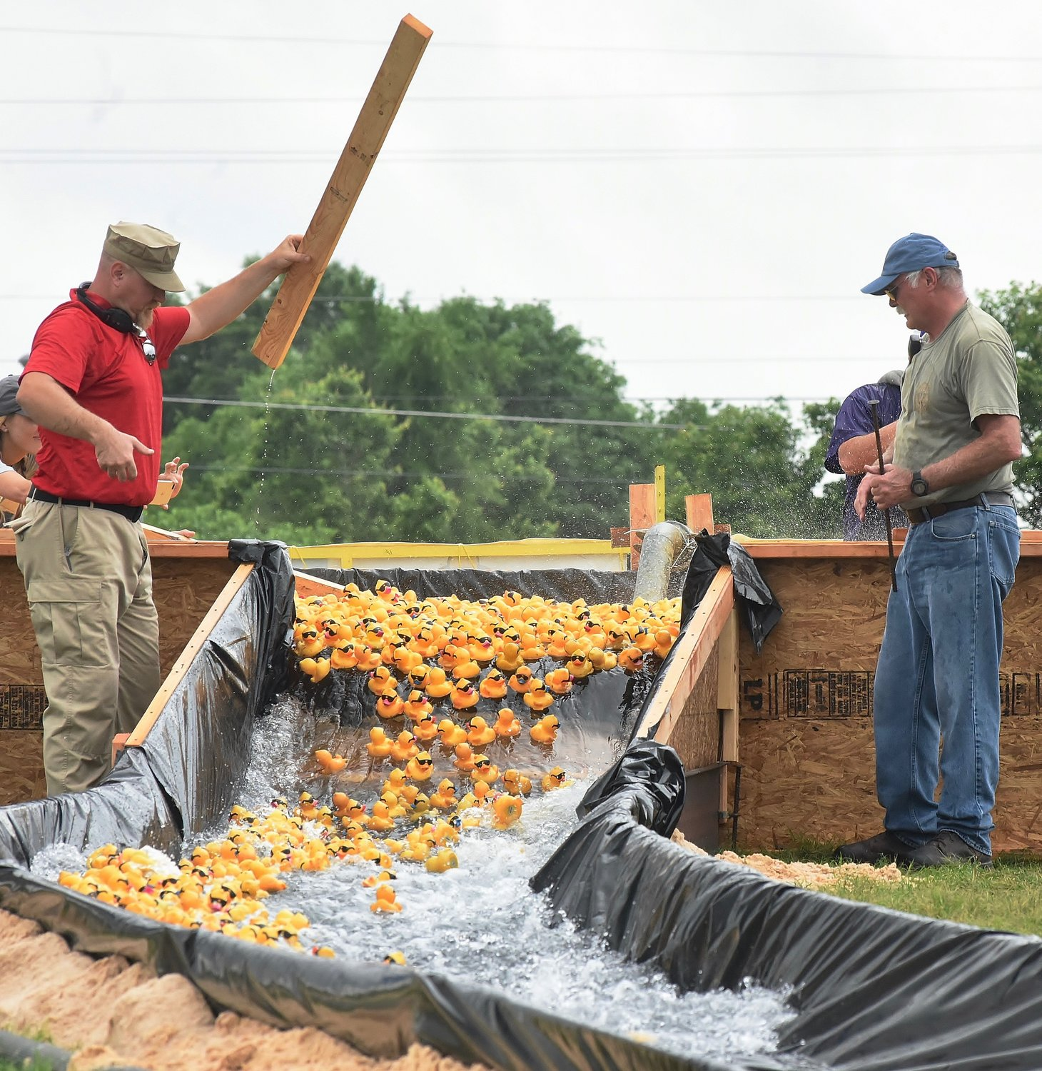 Race officials release a round of ducks in Saturday's Duck Derby at Sam Smith Park.