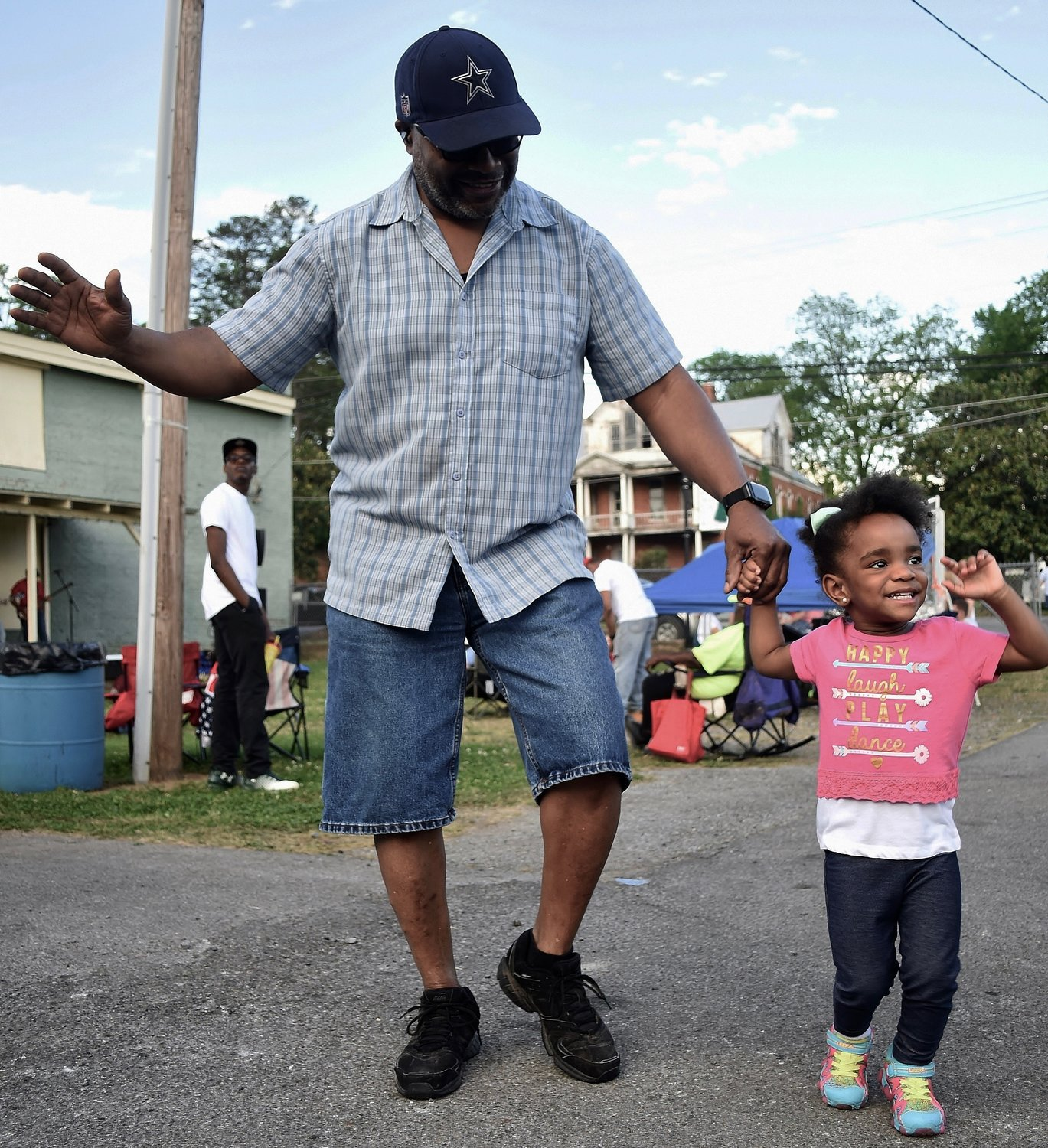 Darren Knight of Cartersville and his daughter Victoria, 2, dance to the music at the third annual Adairsville BBQ & Blues Festival in May 2018.