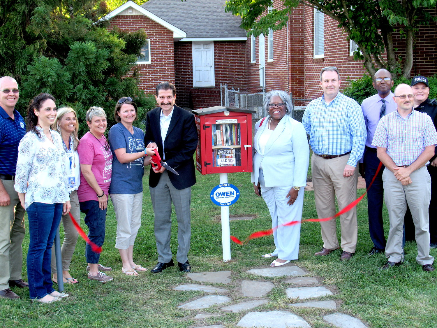 The City of Emerson celebrated the opening of a new Little Free Library outside City Hall with a ribbon-cutting ceremony Monday evening.