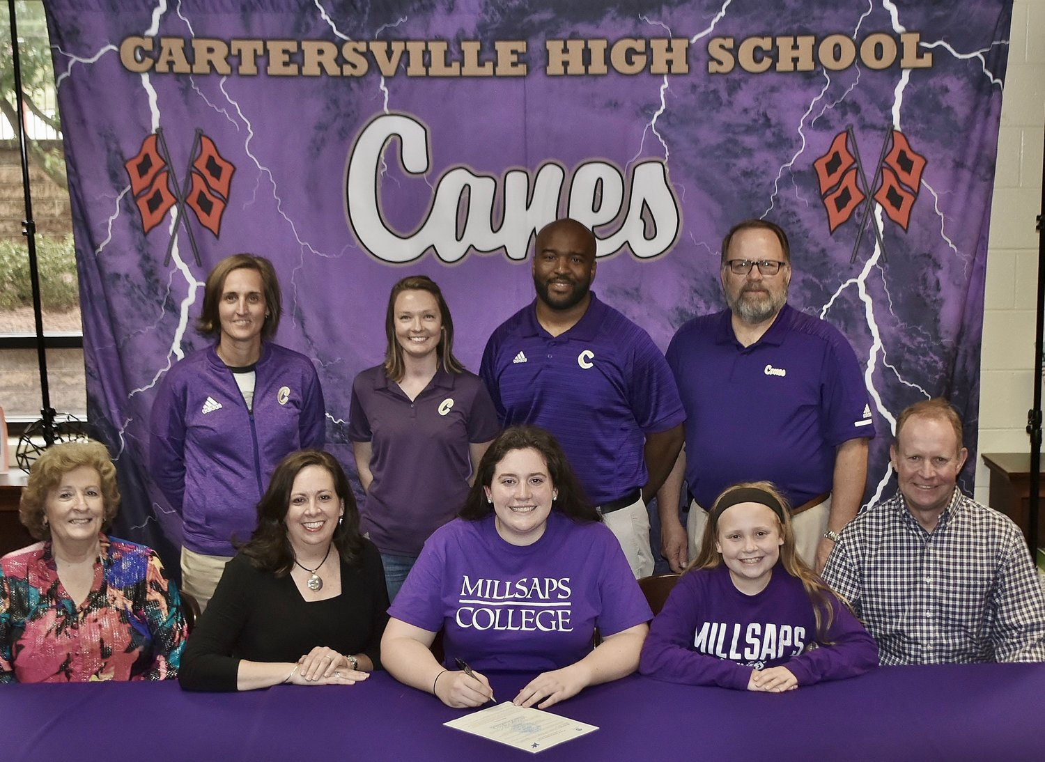 Cartersville High senior Addie Evans signed to play golf at Millsaps College in Jackson, Mississippi. On hand for the signing were, from left, front row: Dorothy Jenkins, grandmother; Angela Evans, mother; Lucy Evans, sister; Shane Evans, father; back row, Shelley Tierce, CHS principal; Megan Boudrie, CHS golf coach; Reggie Perkins, CHS golf coach; and Darrell Demastus, CHS athletic director.