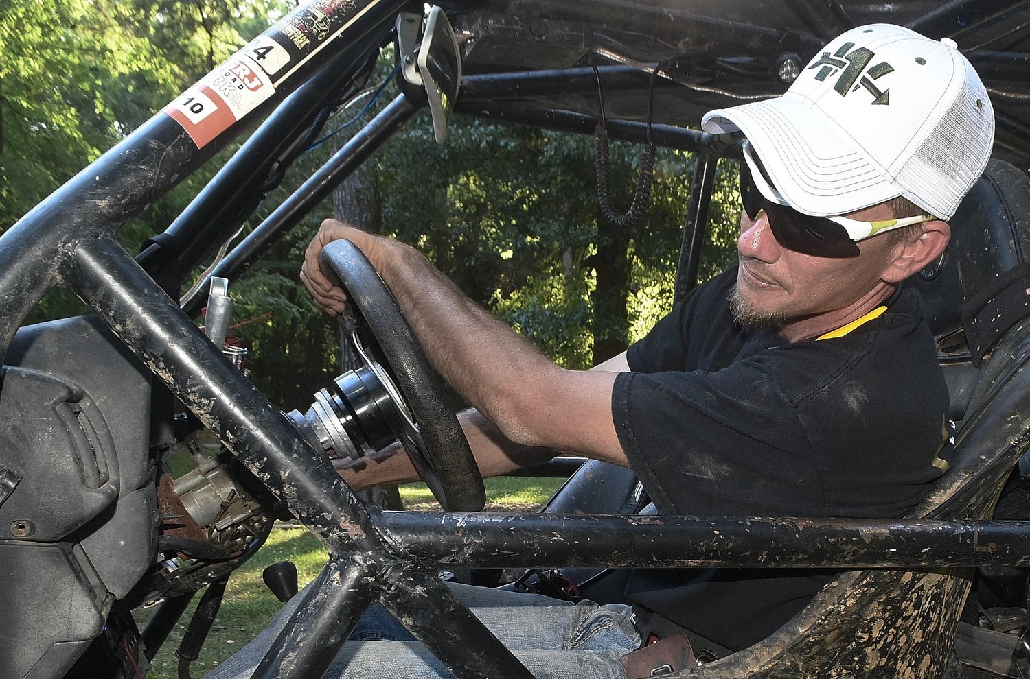 Bartow Krawlers member Kevin Barnett steers his off-road vehicle into a flex position.