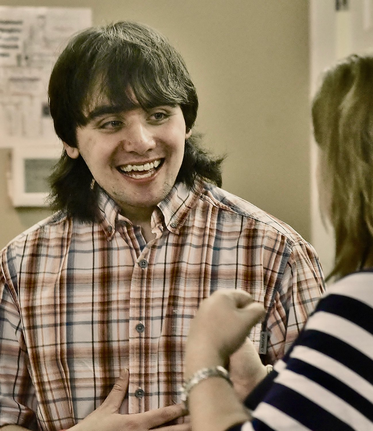 Project SEARCH intern Ronnie Summerfield shares a laugh with Project SEARCH instructor Jennifer Hyde at the organization's graduation ceremony May 16 at Oakland Heights Baptist Church.