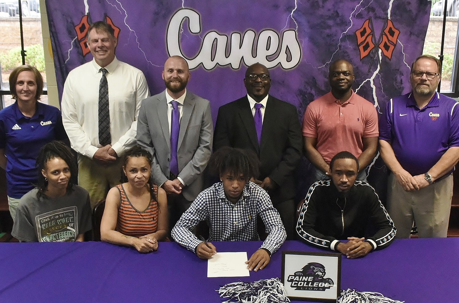 Cartersville High graduate Perignon Dyer signed to play basketball at Paine College in Augusta. On hand for the signing were, from left, front row: DaCola Dyer, sister; Debra Murphy, mother; Tyrell Banks, uncle; back row, Shelley Tierce, CHS principal; Mike Tobin, CHS head basketball coach; Caleb Freeman, CHS assistant basketball coach; Cedric Ward, CHS assistant basketball coach; Wayne Kent, CHS assistant basketball coach; and Darrell Demastus, CHS athletic director.