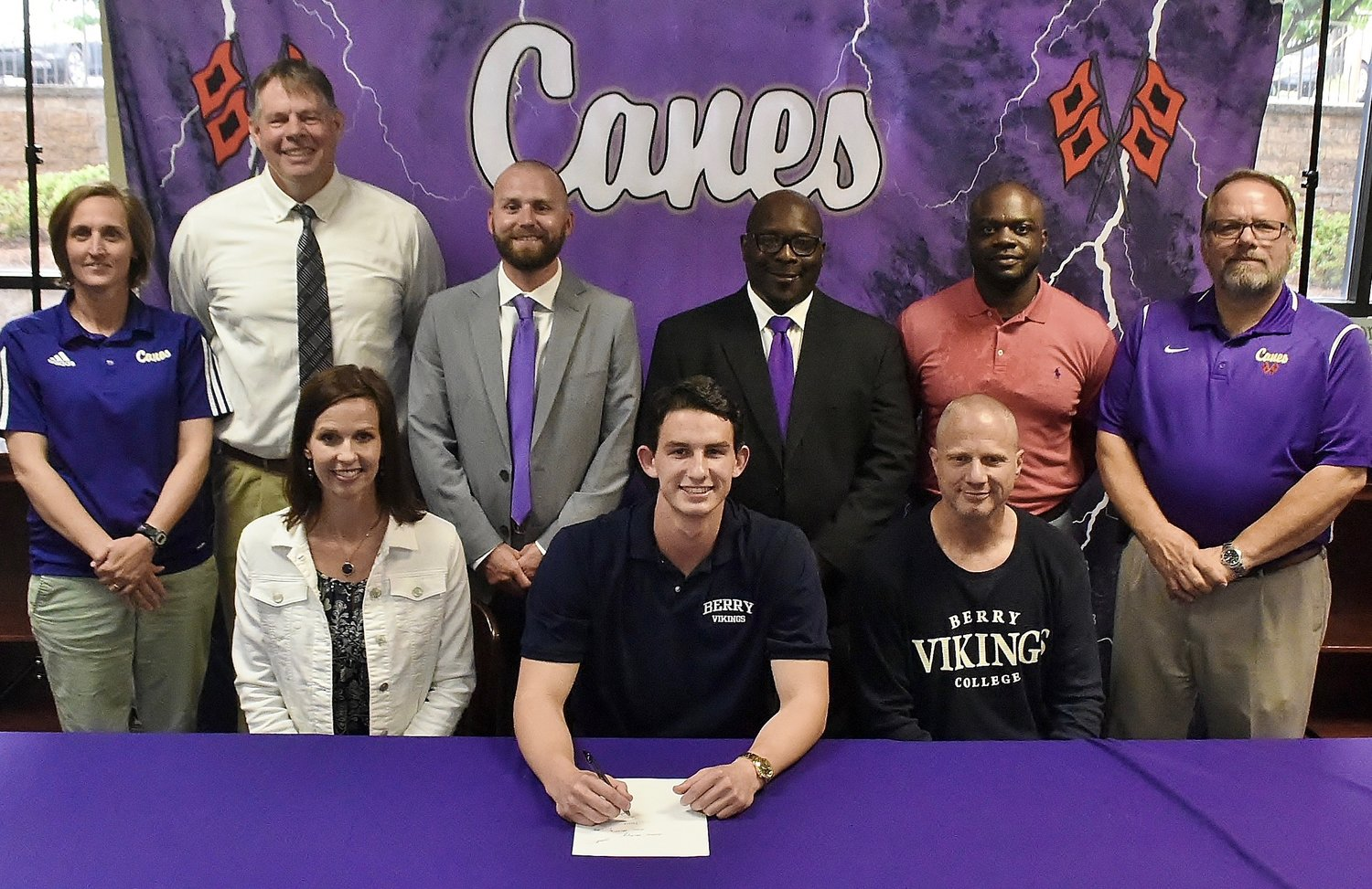 Cartersville High graduate Isaac Gridley signed to play basketball at Berry College in Rome. On hand for the signing were, from left, front row: Holly Gridley, mother; John Gridley, father; back row, Shelley Tierce, CHS principal; Mike Tobin, CHS head basketball coach; Caleb Freeman, CHS assistant basketball coach; Cedric Ward, CHS assistant basketball coach; Wayne Kent, CHS assistant basketball coach; and Darrell Demastus, CHS athletic director.