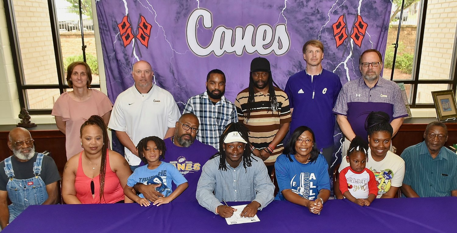 Cartersville High School graduate Marcus Gary signed to play football at Allen University in Columbia, South Carolina. On hand for the signing were, from left, front row, Frank Gary, grandfather; Sarah Miles, cousin; Caleb Gary, brother; Marcus Gary Sr., father; Andrea Legette, mother; Kennedi Payne, niece; Chelsea Gamble, sister; Stanley Ledbetter, grandfather; back row, Shelley Tierce, CHS principal; Jeremy Knight, CHS running backs coach; Onigh McMoore, godbrother; Lee Miles, cousin; Conor Foster, CHS head football coach; and Darrell Demastus, CHS athletic director.