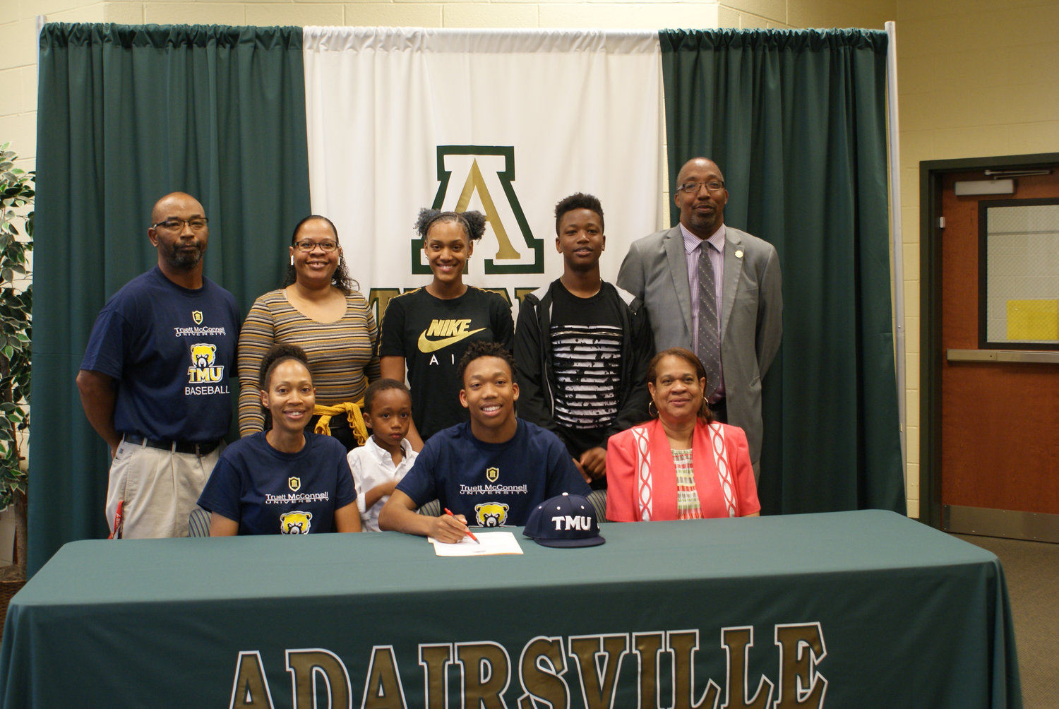 Recent Adairsville High graduate B.J. Roper signed to play baseball at Truett McConnell. On hand for the signing ceremony were, from left, front row: Tamara Roper, mother; Trey Roper, brother; Donna Watkins, grandmother; back row, Billy Roper, father and AHS head baseball coach; Kisha Slaughter, aunt; Justyce Moore, cousin; Chris Roper, brother; and Sammie Roper, uncle.