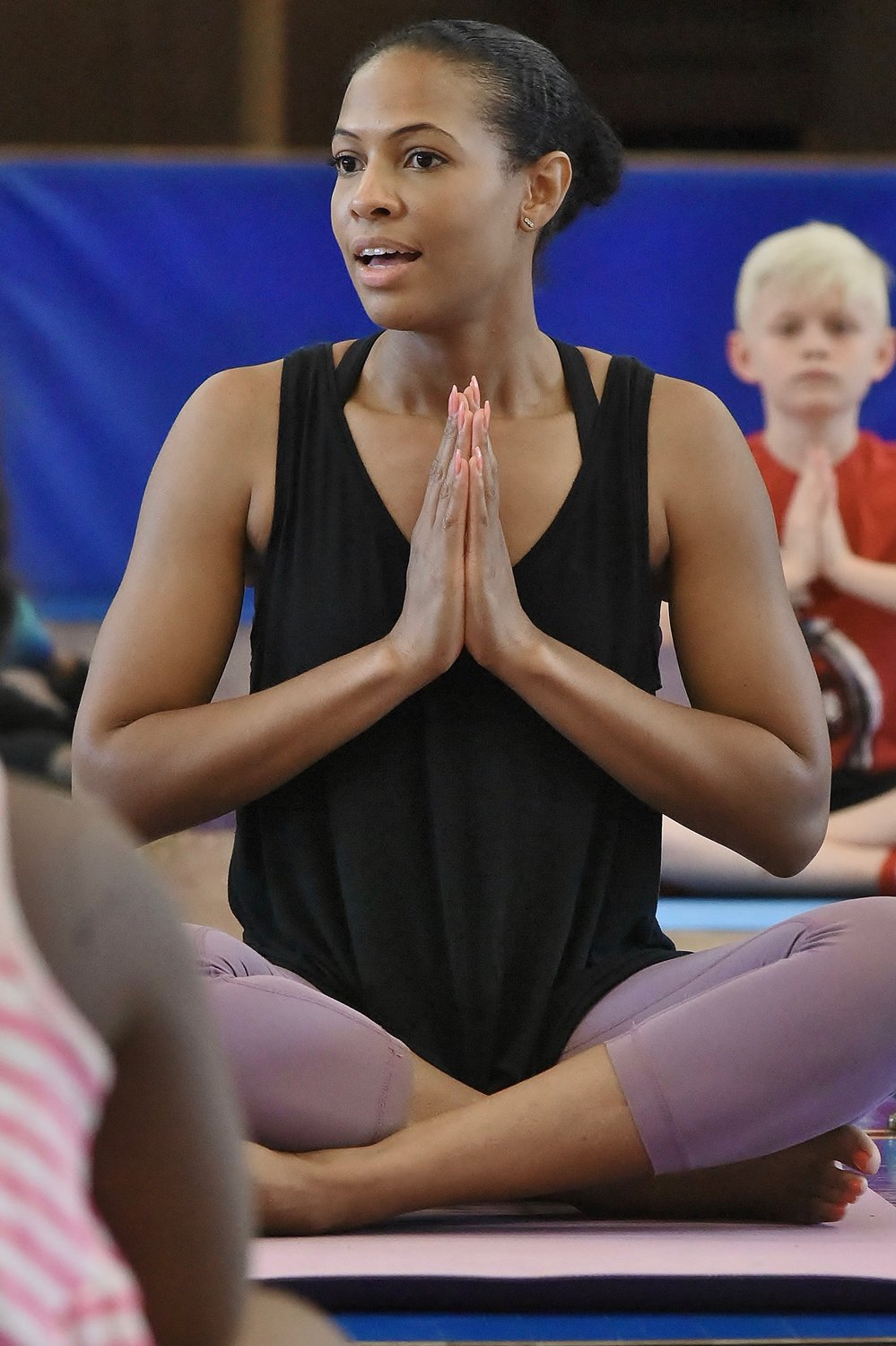 Certified Yoga Instructor Ashley Johnson teaches the Yoga ... Anyone? program at the J.H. Morgan Gym in Cartersville June 4.