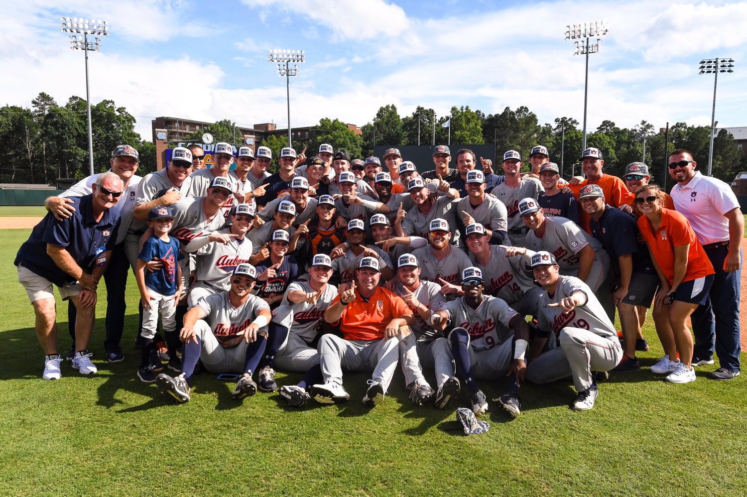 Members of the Auburn baseball team celebrate a win over North Carolina Monday in Chapel Hill. The victory sends the Tigers to the College World Series in Omaha.