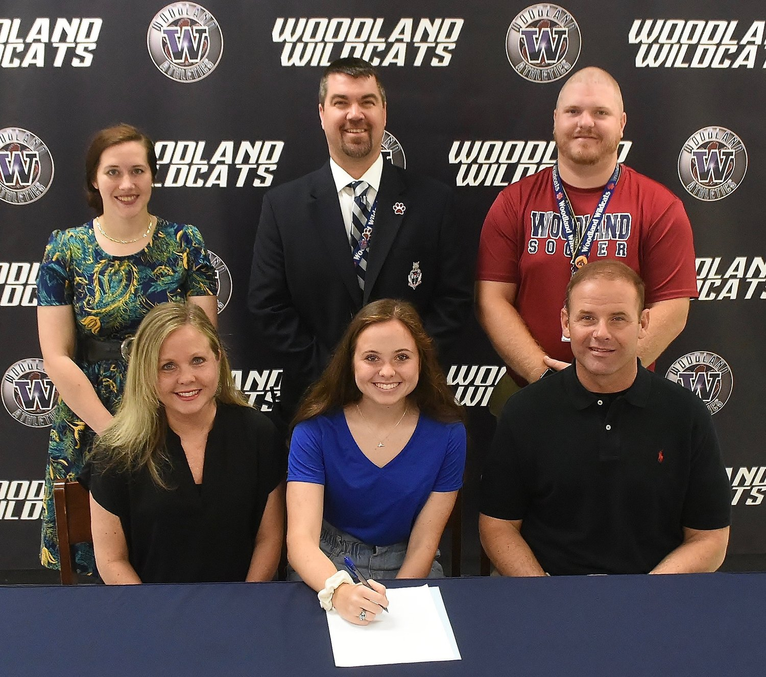Recent Woodland High graduate Molly Plott signed to play soccer with Shorter University. On hand for the signing were, from left, front row, Robin Plott, mother; Tony Plott, father; back row, Nicole Heiser, WHS girls soccer coach; John Howard, WHS athletic director; and Jonathan Cannon, former WHS girls soccer coach.
