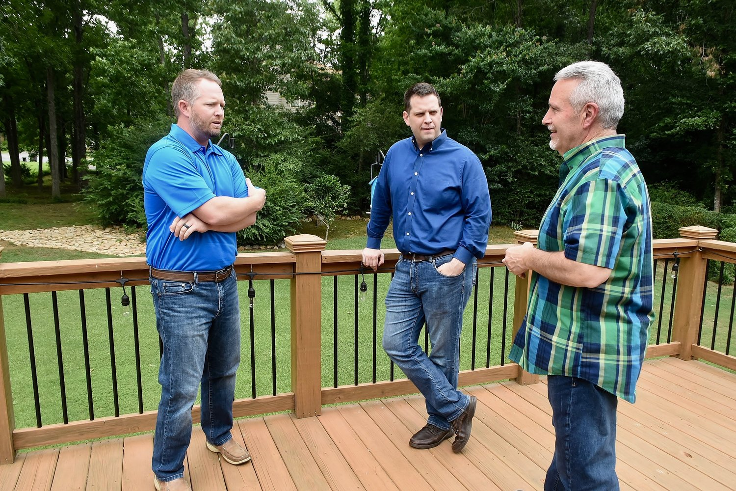 Don Startup, right, on the deck of his Cartersville home, with his sons Drew, left, and Nick. Startup's third son, Will, lives in Cumming and works in Norcross.