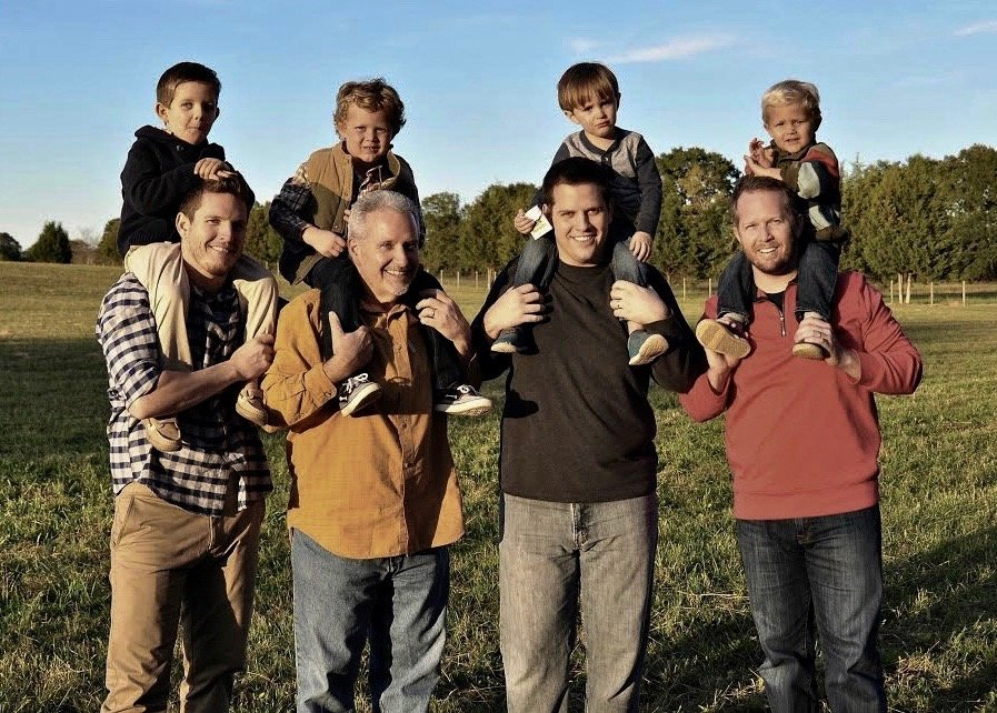 Don Startup, second from left, holding grandson Price, with his sons and other grandsons, from left: Will, holding Copeland; Nick, holding Jude; and Drew, holding Henley.