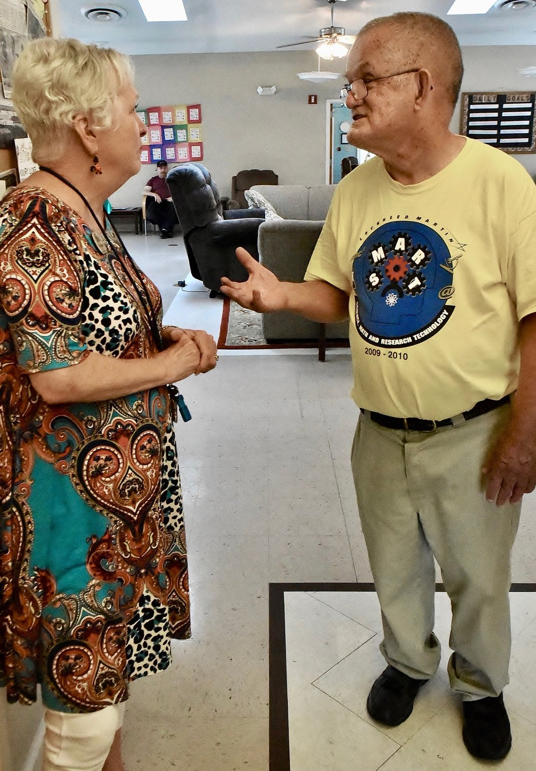 Hickory Log Vocational School resident Elmer Smith, right, speaks with the facility's Interim Executive Director Patty Eagar.