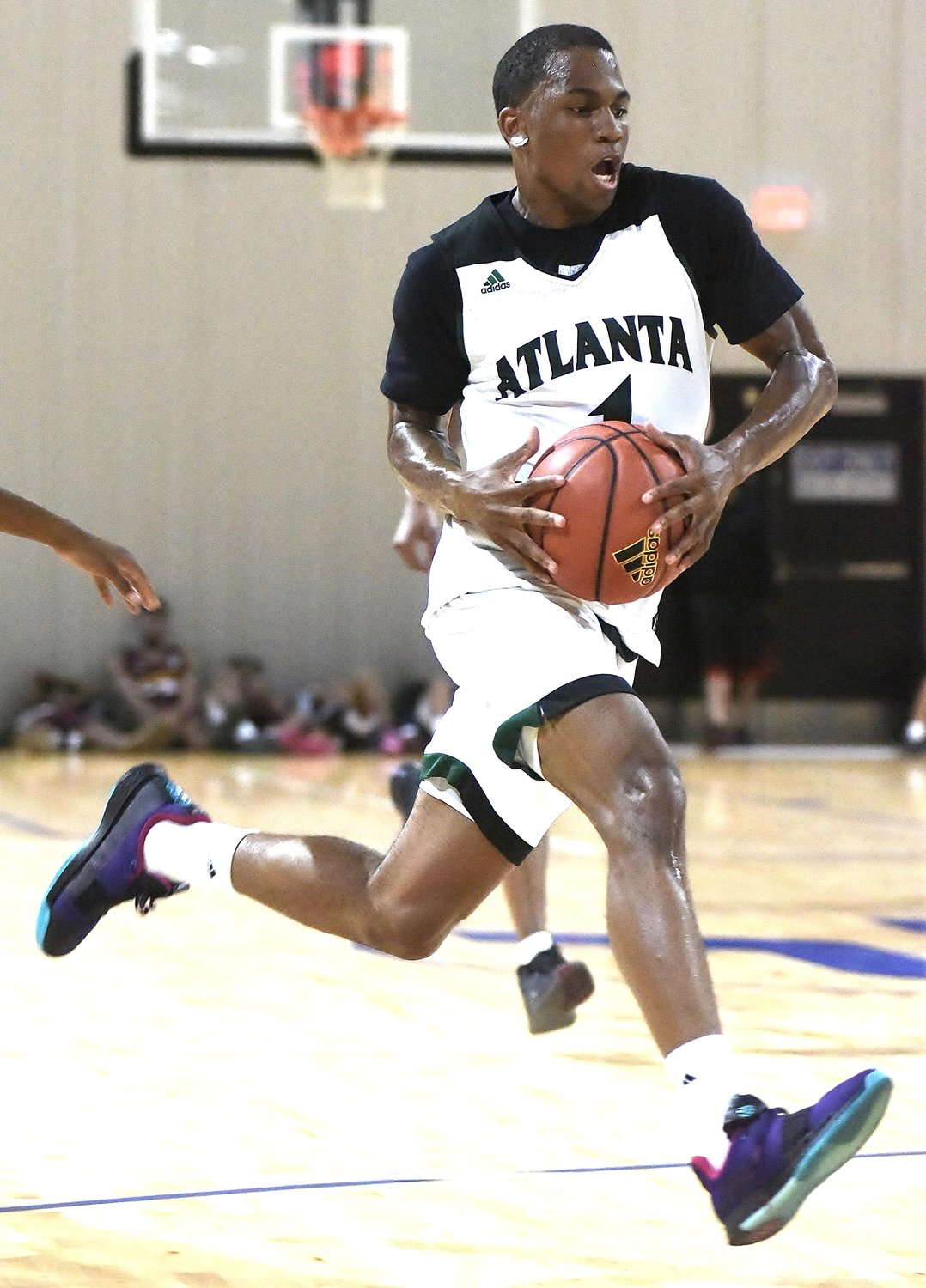 Atlanta Celtics guard Dwon Odom drives towards the basket during a game in the adidas Gauntlet stop at LakePoint's Champions Center this spring. Odom, who is committed to Xavier, and the Celtics will be back in Bartow County Sunday for the second edition of the Battle for Georgia.